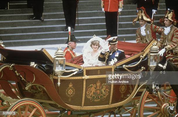Charles Prince of Wales and his wife Princess Diana wave to the crowds following their wedding ceremony at St Paul's Cathedral London