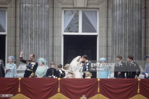 Members of the royal family on the balcony at Buckingham Palace following the wedding of Prince Charles and Princess Diana Also present are Prince...