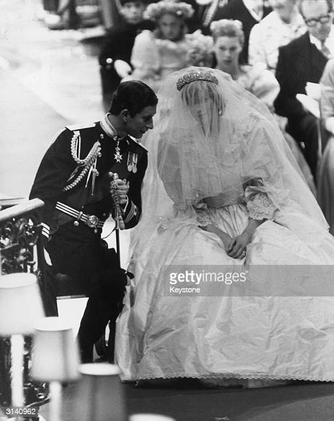 Prince Charles leans attentively towards his bride, Diana Princess of Wales during their wedding ceremony in St Paul's cathedral.