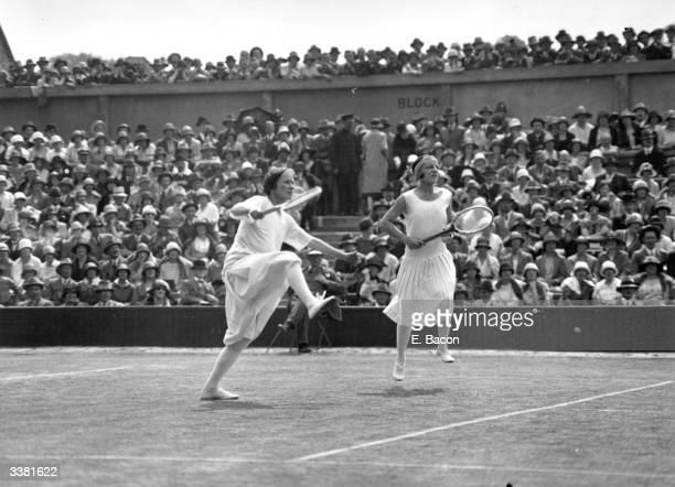 Suzanne Lenglen of France and doubles partner Bunny Ryan of the USA in  action during their e66207620acff