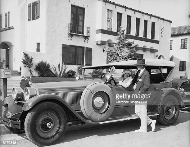 French leading lady of the silent era Renee Adoree , in her luxurious car.
