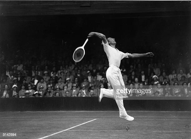 British tennis player Fred Perry in action against BH Grant in court number one at Wimbledon