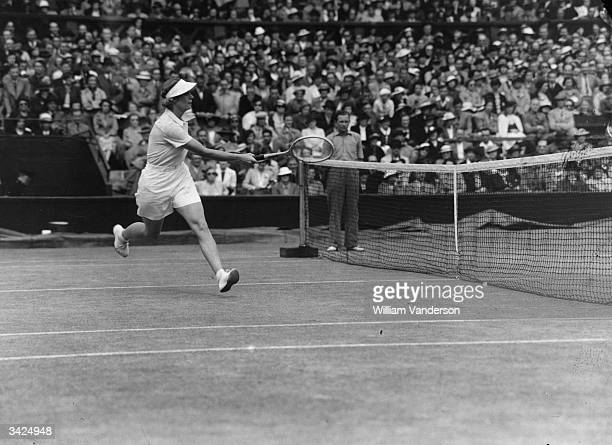 American tennis player Alice Marble in action at the Wimbledon Lawn Tennis Championships