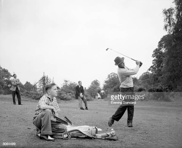 American golfer Sam Snead with his son Jackie whilst warming up for a Canada Cup golf game