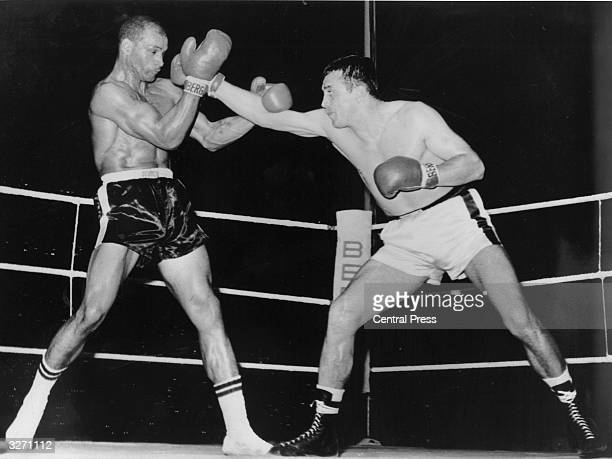 Boxer Harold Johnson the world light heavyweight champion during a title fight against German boxer Gustav Scholz Johnson retained his title