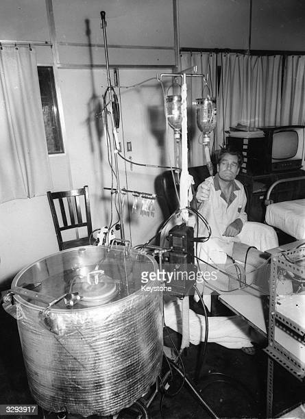 A patient is plugged in to an artificial kidney at the Royal Free Hospital in London