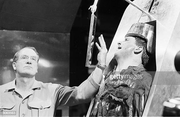 O'Brien tortures the hapless Winston Smith in a BBC TV production of George Orwell's classic novel '1984'