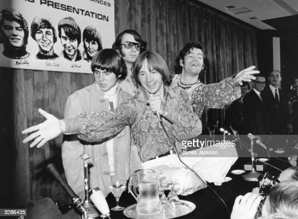 Top American pop group the Monkees originally formed to play the part of a pop group for a comedy television series enliven a press conference in...