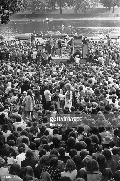 A crowd of young hippies watching British folkrock group Jethro Tull at the first pop concert to be held in Hyde Park London on the banks of Lake...