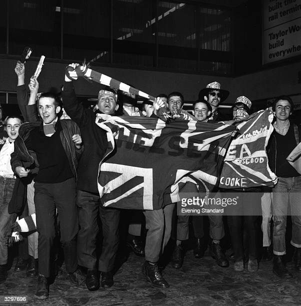 A happy group of Chelsea fans wave the Union Jack
