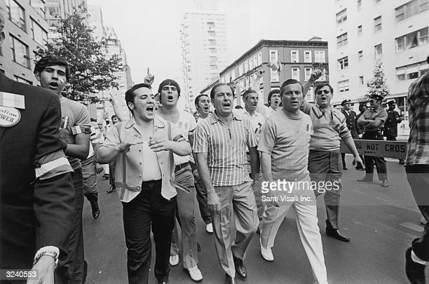 Joseph Colombo of the organized crime family marches with others during the Italian Unity Day Parade which he organized New York City