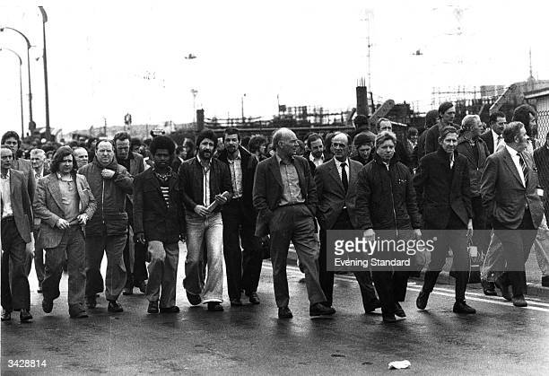 Ford workers leaving a strike meeting