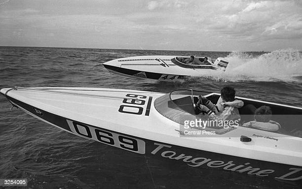 Peter and Jan Armstrong of Worthing race each other on the open sea each carrying one son as a passenger