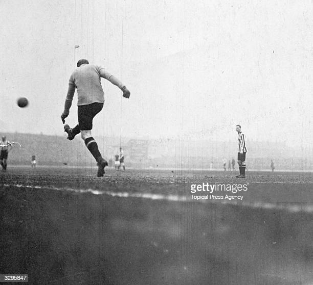 The Sunderland FC goalkeeper kicks the ball upfield as Burnley and Sunderland meet in the FA Cup semifinal at Hillsborough Stadium Sheffield