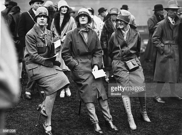 Well protected against the weather women spectators at the first day of the Liverpool Spring Meeting at the Aintree racecourse
