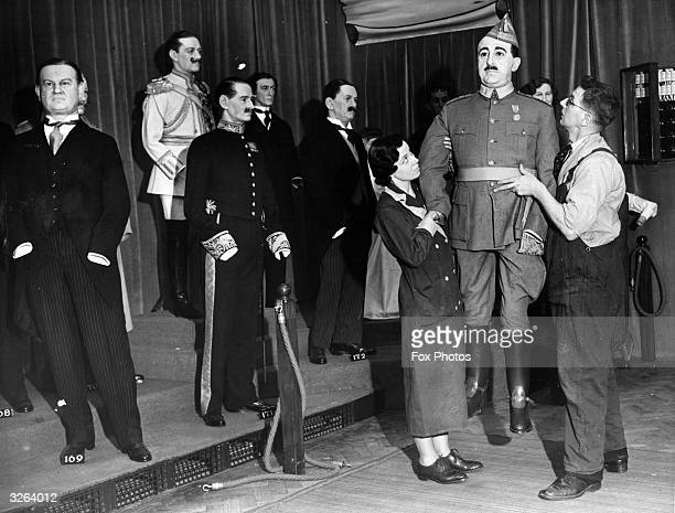 Employees at Madame Tussaud's in Blackpool move a wax figure of Spanish dictator Francisco Franco into position.