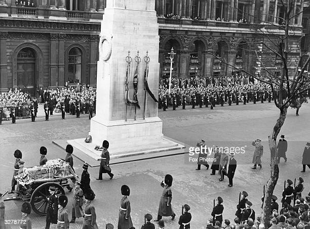 The funeral cortege of Queen Mary makes its way through London past the cenotaph
