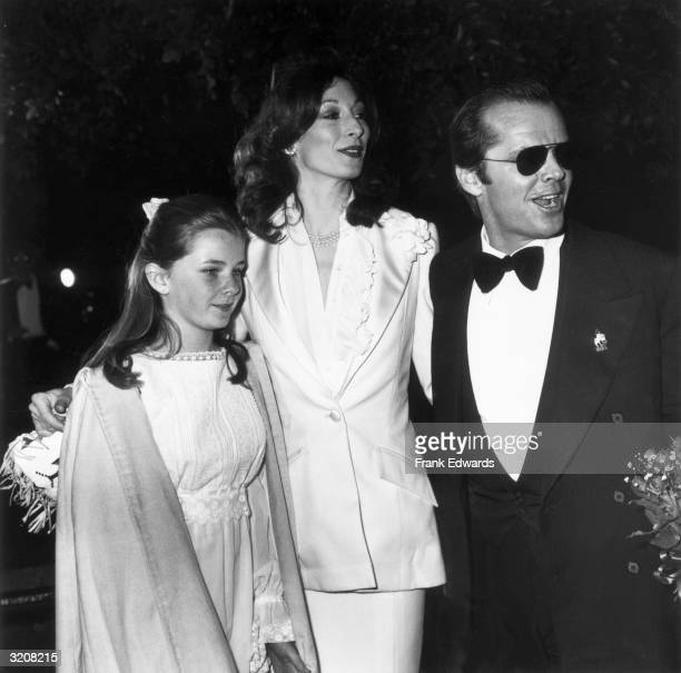 American actors Anjelica Huston and Jack Nicholson and Nicholson's daughter Jennifer attend the Academy Awards held at the Dorothy Chandler Pavilion...