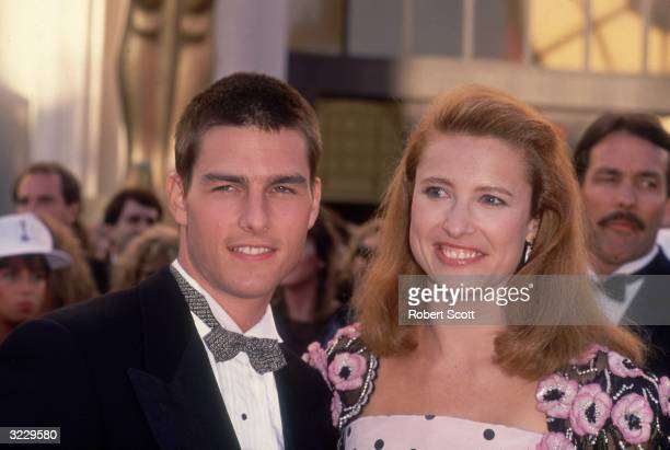 Headshot of married American actors Tom Cruise and Mimi Rogers smiling at the Academy Awards, Shrine Auditorium, Los Angeles, California, March 29,...