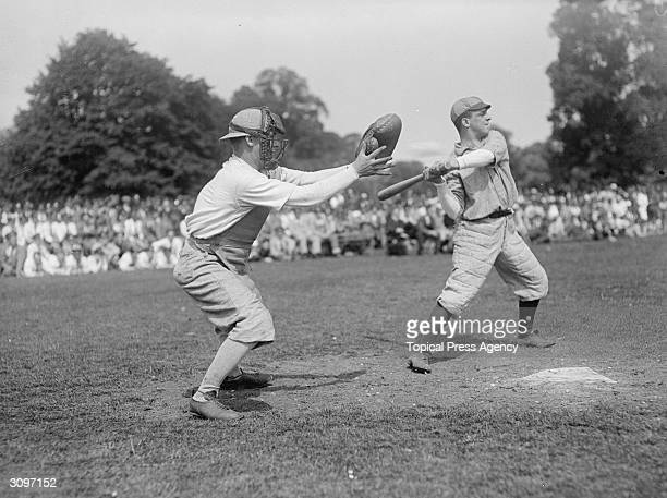 American medical staff hold a baseball match at Epsom The batter and the catcher are ready for action