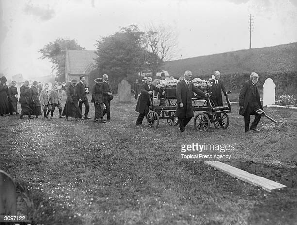 Funeral procession approaches a newly dug grave at the funeral of Folkestone airraid victims