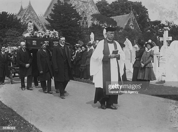 The vicar heading the funeral procession of those killed in the air raid on Folkestone