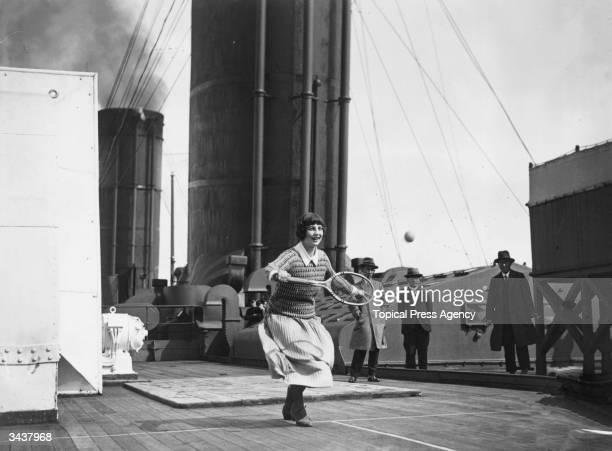 American tennis player Helen Wills Moody practising on the deck of the Berengaria during her journey from American to England