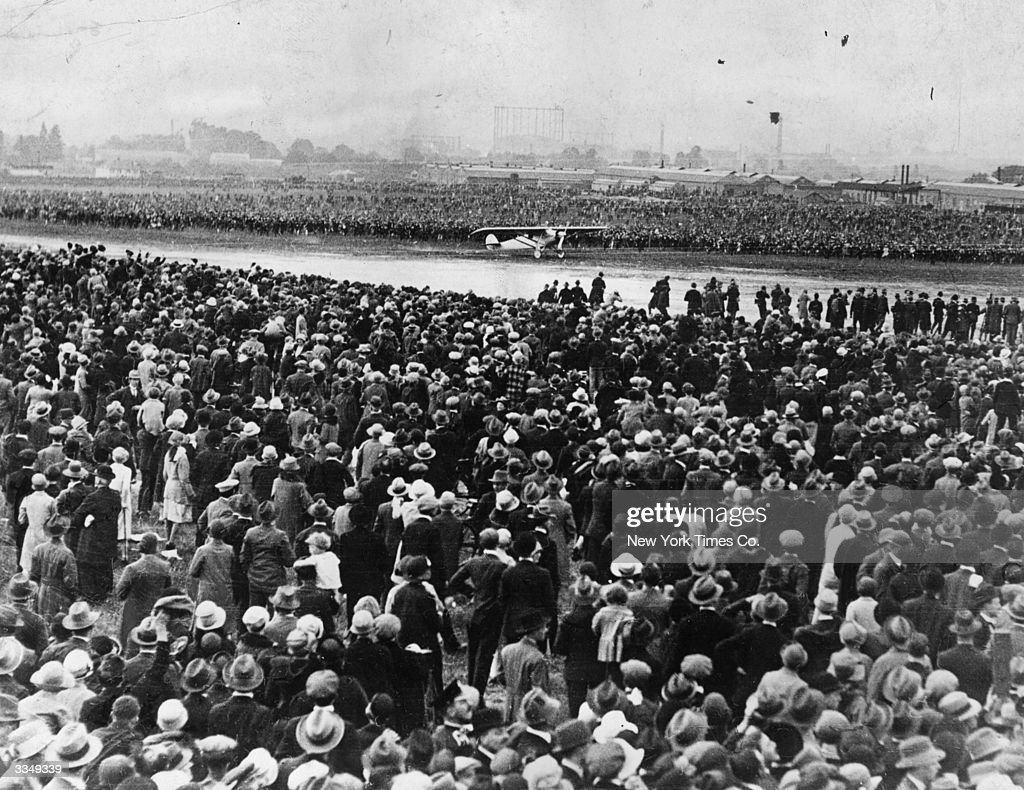 Thousands of spectators watch Charles Lindbergh arriving at Croydon, London in his Ryan 'Spirit Of St Louis', soon after completing the first direct, solo transatlantic flight from America to France.