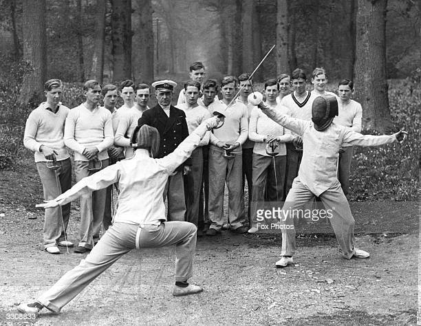 A group of boys watch a demonstration of fencing in the grounds of Pangbourne College