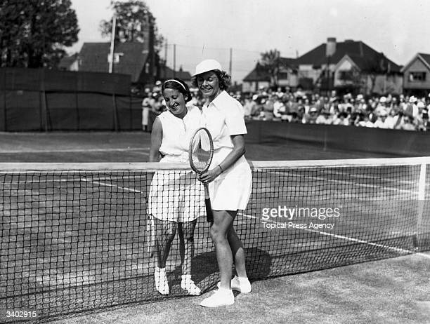 American tennis player Alice Marble congratulating Chile's Anita Lizana after the latter won the final of the Middlesex Lawn Tennis Championship at...