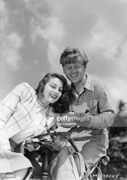 Actress Ava Gardner plays a round of golf with her husband former child actor Mickey Rooney