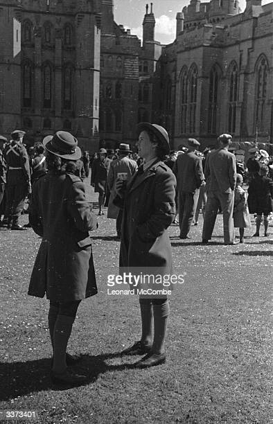 Two Land Girls chatting in the courtyard of Arundel Castle during the West Sussex Land Girls' rally Original Publication Picture Post 1445 Snapshots...