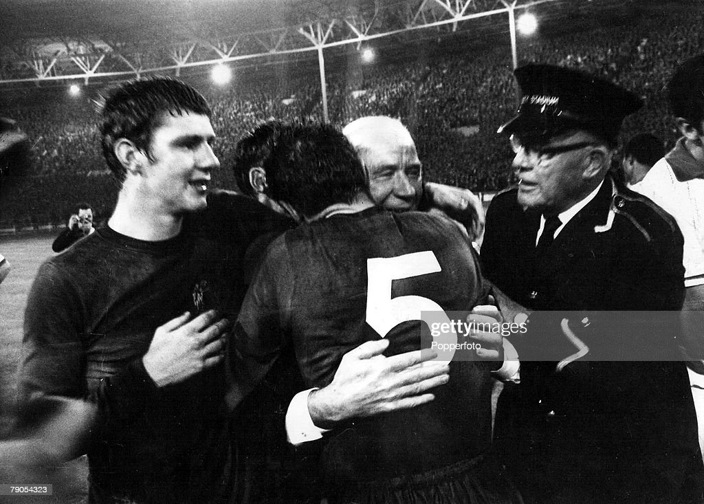29th MAY 1968, European Cup Final, 1968, Wembley, London, Manchester United (4) v Benefica (1), Manchester United's Brian Kidd (L) watches as his manager Matt Busby is hugged by Bill Foulkes after their historic win