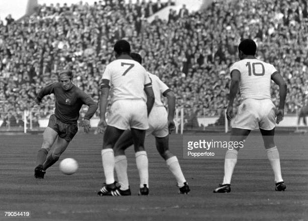 29th MAY 1968 European Cup Final Wembley London Manchester United v Benefica Manchester United's captain Bobby Charlton is faced by three Benfica...