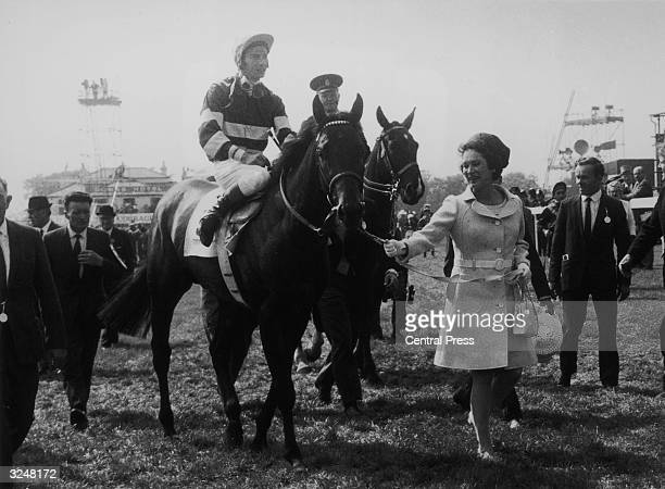 Lester Piggott riding Raymond R Guest's Irish trained horse Sir Ivor to the unsaddling enclosure after winning the Derby at Epsom.