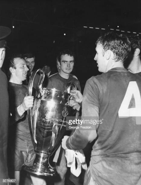 Manchester United players, with the European Cup after beating the portuguese side Benfica 4-1after extra time in the European Cup final at Wembley...