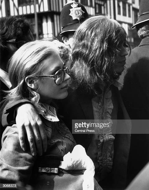 Mick Jagger of the Rolling Stones and his girlfriend Marianne Faithfull arrive at the Marlborough Street magistrate's court London the day after drug...