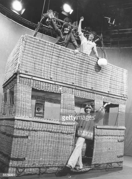 Presenters of the childrens television programme Blue Peter Peter Purves John Noakes and Leslie Judd inside a giant basket 'house' which is the...