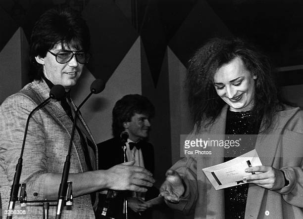 Pop star Boy George presents the National DJ of the Year award to Radio One presenter Mike Read at the 1984 Sony Radio Awards