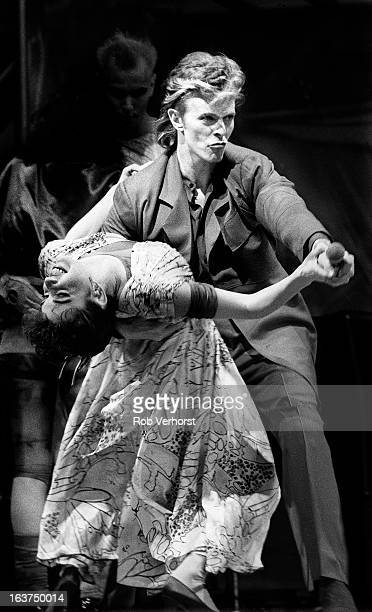 29th MAY: David Bowie performs live on stage with dancer Melissa Hurley at the Feijenoord Stadium in Rotterdam, Netherlands during his Glass Spider...