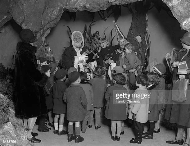 Group of young children pay a visit to the 'Land of Good Luck' in Selfridges, London to share their Christmas wishes with Santa and his elf.