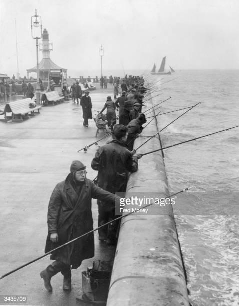 Fishermen at the pier in Lowestoft Suffolk