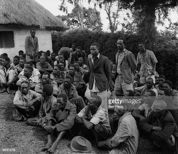 A group of 300 members of the Kikuyu tribe listen to a speech by Robert Nimmo District Officer of Kenya in which he announces the intention of the...