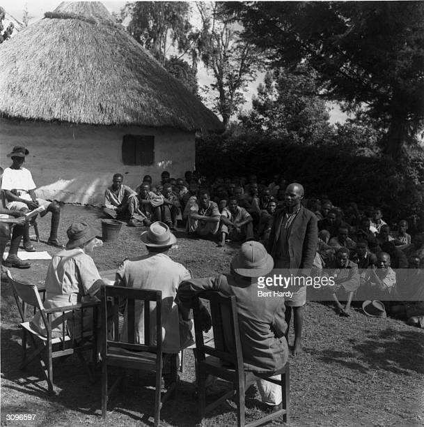 District Officer Robert Nimmo questions a member of the Forty Group which controls the Mau Mau Original Publication Picture Post 6223 Mau Mau 'Get...