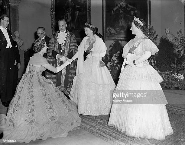 Queen Elizabeth The Queen Mother greeting Mrs Geralde Legge with Queen Elizabeth II at a party hosted by the Mayor of Westminster at the Royal...