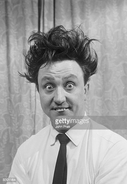 English comedian Ken Dodd with his trademark wild hair and buck teeth
