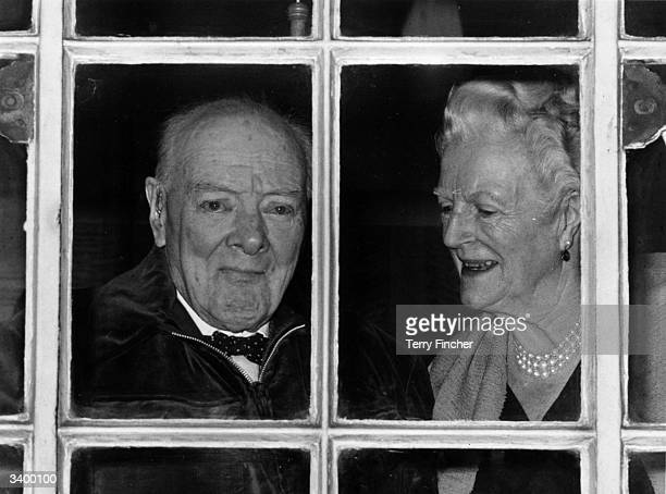 British politician and former Prime Minister Sir Winston Churchill and his wife Lady Clementine Churchill celebrating his ninetieth birthday at their...