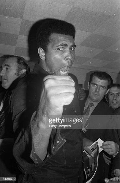 American boxer Muhammad Ali formerly Cassius Clay strikes an aggressive pose at a press conference