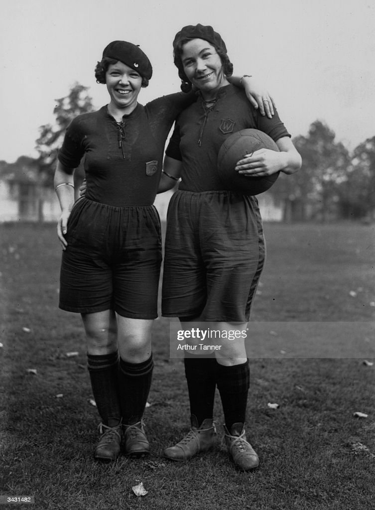 Two sisters, Irene (right) and Clive Hawthorne, who are to captain rival football teams in a match in Staines, Middlesex.