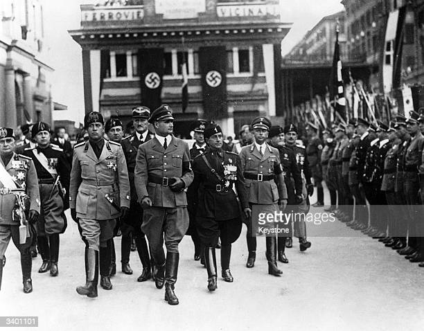 Rudolf Hess a German statesman in Hitler's Nazi party cabinet inspects the Guard of Honour in Rome accompanied by Count Galeazzo Ciano and General...